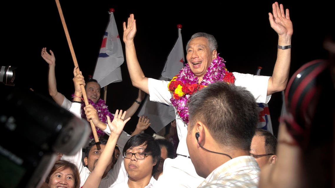 Singapore's Prime Minister Lee Hsien Loong of the ruling People's Action Party celebrate a win in his constituency in Singapore, Saturday, Sept. 12, 2015. (AP)