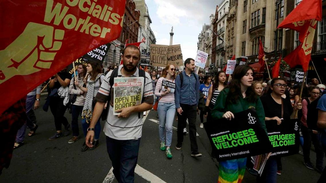 Protesters march towards from Trafalgar Square towards Downing Street during a demonstration to express solidarity with migrants and to demand the government welcome refugees into Britain, in London. (Reuters)