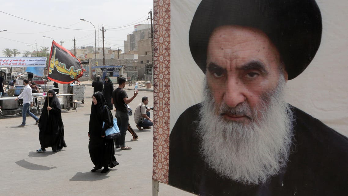 A poster of Shiite spiritual leader Grand Ayatollah Ali al-Sistani, right, in Baghdad, Iraq, Thursday, May 22, 2014. (File photo: AP)