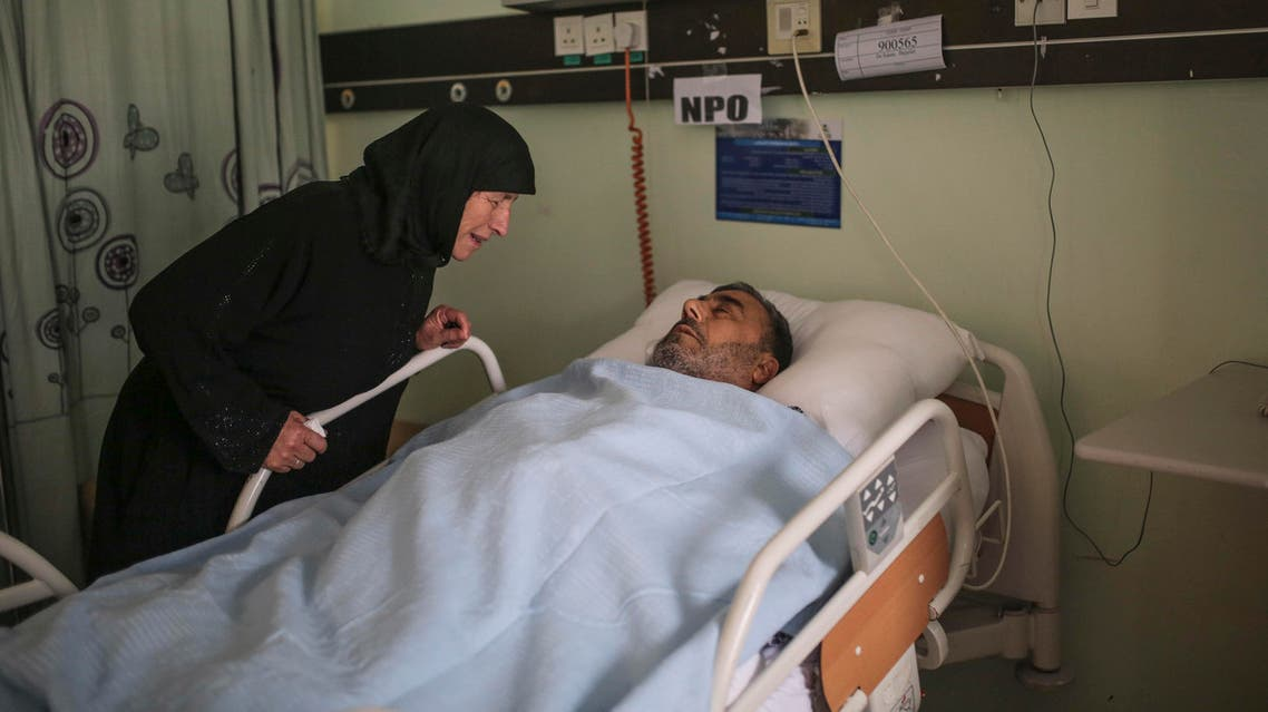A Syrian pilgrim cries next to her husband who was injured after a construction crane collapsed at the Grand Mosque in the Muslim holy city of Mecca, while visiting him in Al Nour specialist hospital, one of the main hospitals where victims of the collapse were transferred in Mecca, Saudi Arabia, Sunday, Sept. 13, 2015. (A