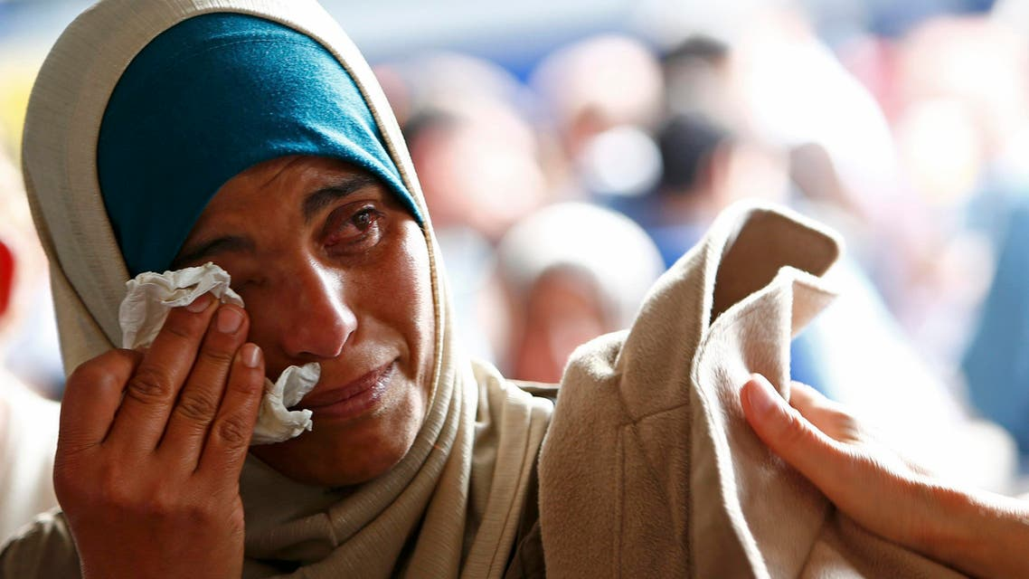 yrian refugee Asmaa wipes tears as she waits for a train on the platform at the main railway station in Munich, Germany September 13, 2015. (Reuters)