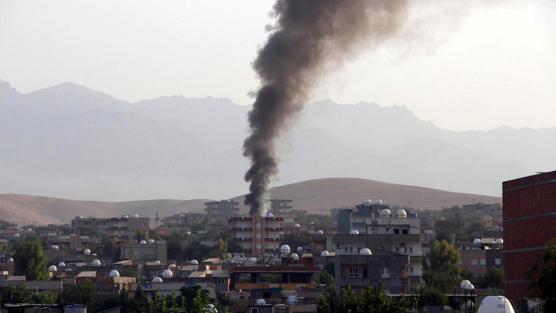 Smoke billows from a fire during firefight between the police and Kurdistan Workers' Party,