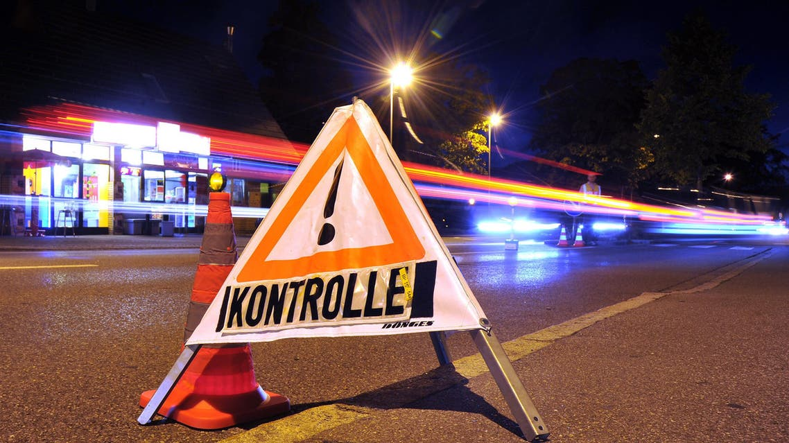 aug102 - Lindau, Bavaria, GERMANY : A sign reading 'control' ('Kontrolle') stands on the road at the German-Austrian border near Lindau, southern Germany, on September 13, 2015. Germany said it was reinstating border controls on Sunday as Europe's top economy admitted it could no longer cope with a record influx of refugees. AFP PHOTO / DPA / STEFAN PUCHNER +++ GERMANY OUT