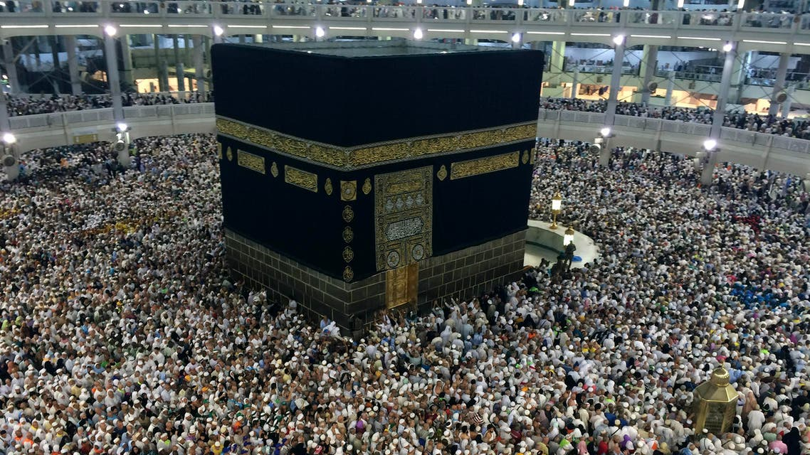 Muslim pilgrims circle the Kaaba, the black cube at center, inside the Grand Mosque during the annual pilgrimage, known as the hajj,