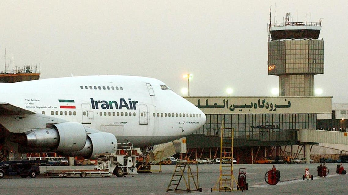 """** FILE ** A Boeing 747 of Iran's national airline is seen at Mehrabad International airport in Tehran, in this June 2003 file photo. Iran's national airline plans to add more American-made planes to its fleet, despite the U.S. aviation sanctions against the Islamic country, an official said Monday March 6, 2006. """"There are different purchase projects in hand, including American planes"""", Malek Barzegar Sedigh, spokesman of Iran Air, Iran's national airline, told the Associated Press. """"I do not give further details because then Americans could easily thwart the deal,"""" Sedigh said.(AP Photo/Hasan Sarbakhshian, file)"""