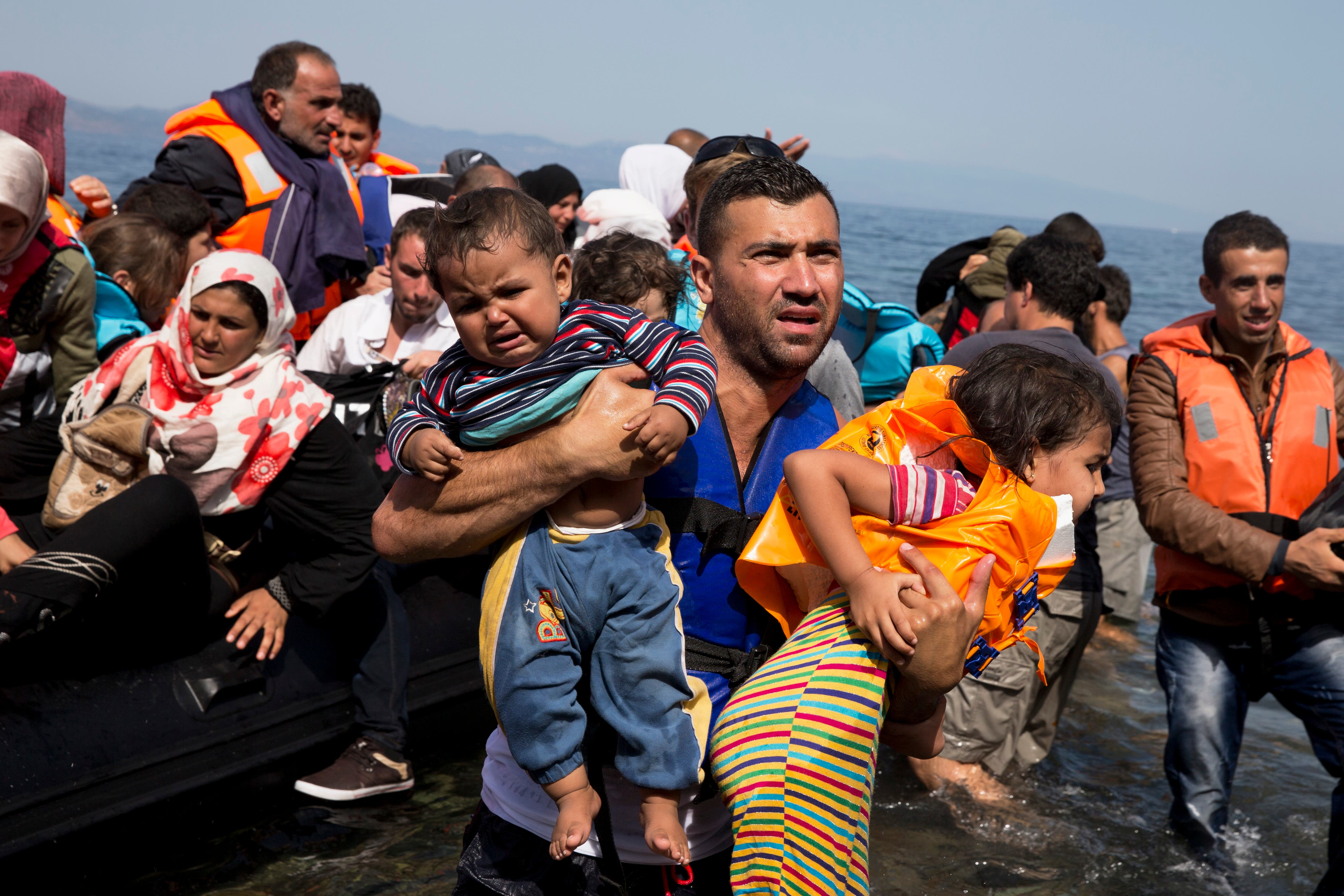 Syrian refugees arrive aboard a dinghy after crossing from Turkey to the island of Lesbos, Greece. (File photo: AP)