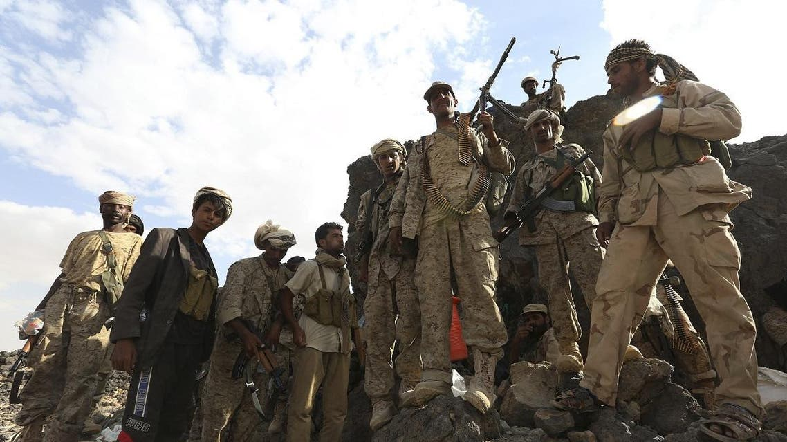Soldiers loyal to Yemen's exiled government stand at an area where they are fighting against the Houthi militia in Yemen's central province of Marib. (Reuters)