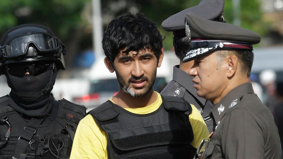 Police officers escort a key suspect in last month's Bangkok bombing, yellow shirt, identified by Thai police as Yusufu Mierili. (File photo: AP)