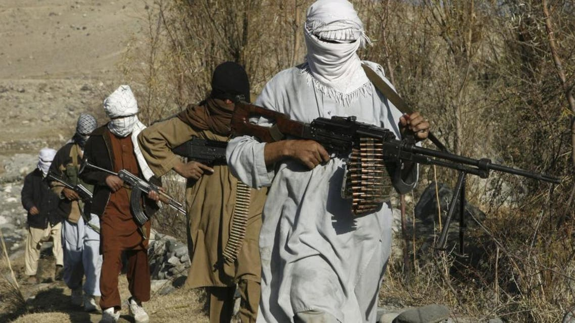 Taliban fighters pose with weapons reuters