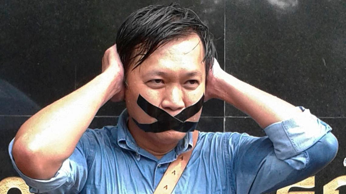 Pravit Rojanaphruk, an outspoken Thai columnist for the English-language daily The Nation, poses for a photograph while being called to report himself to the ruling military last year. (File photo: AP)