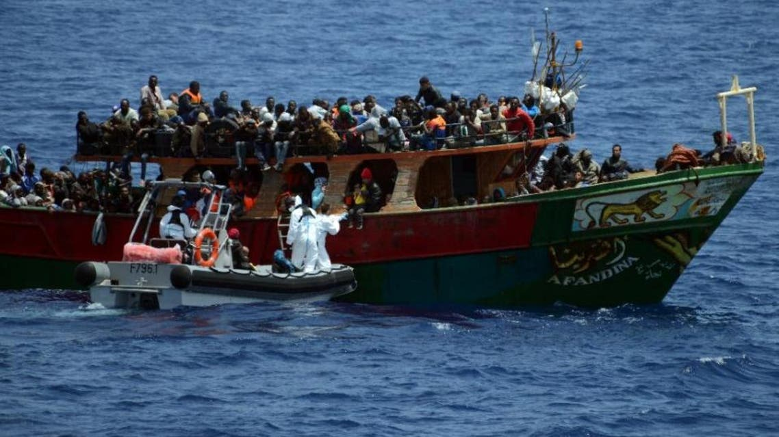 A French Navy patrol ship rescues migrants aboard a fishing boat in the Mediterranean Sea, on May 20, 2015 (AFP)