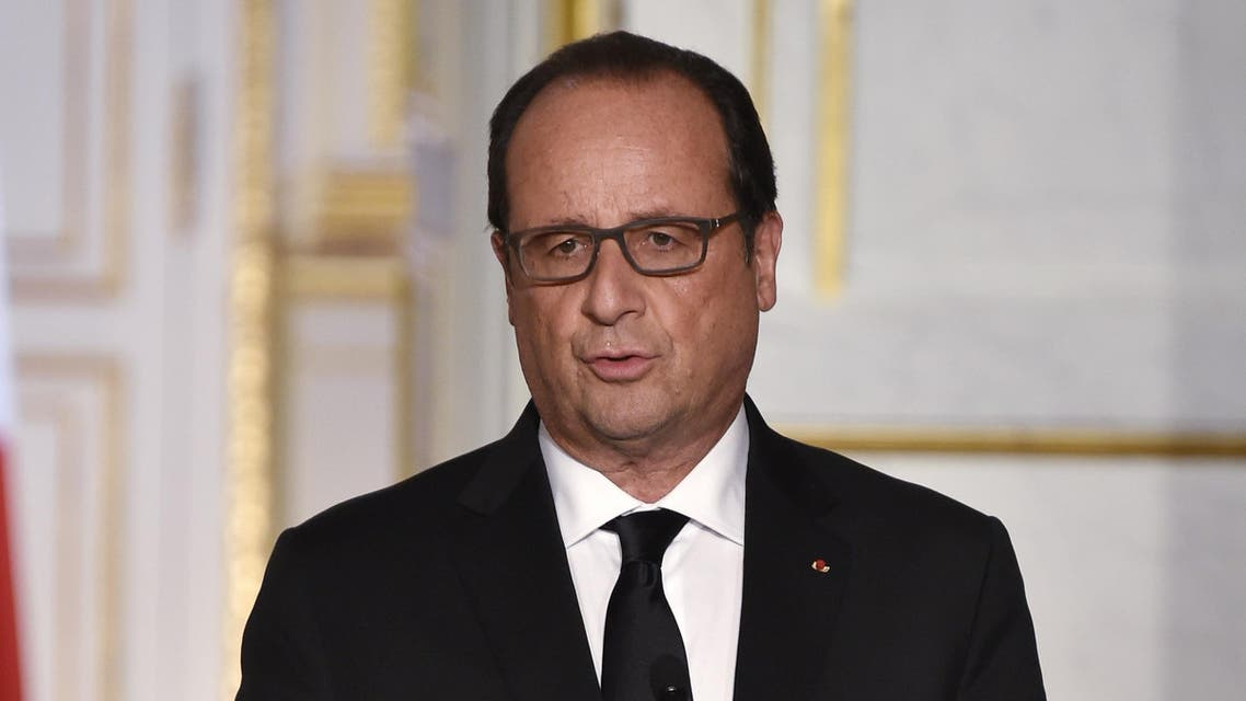 French President Francois Hollande gives a press conference with his Nigerian counterpart at the Elysee Presidential Palace in Paris on September 14, 2015.