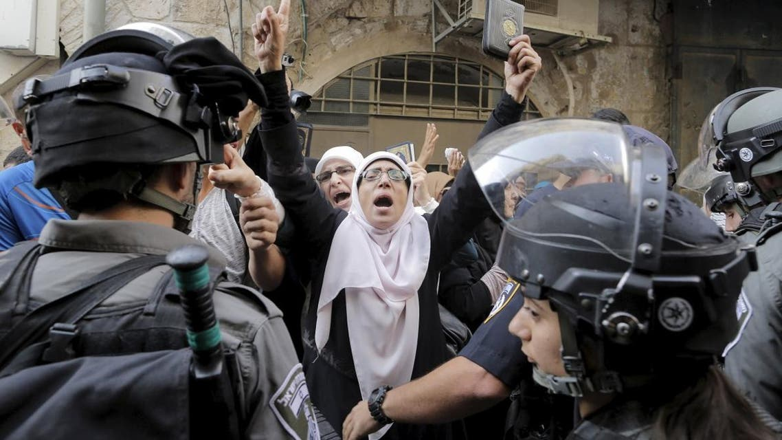 Israeli policemen prevent Palestinian women from entering the compound which houses al-Aqsa mosque. (Reuters)