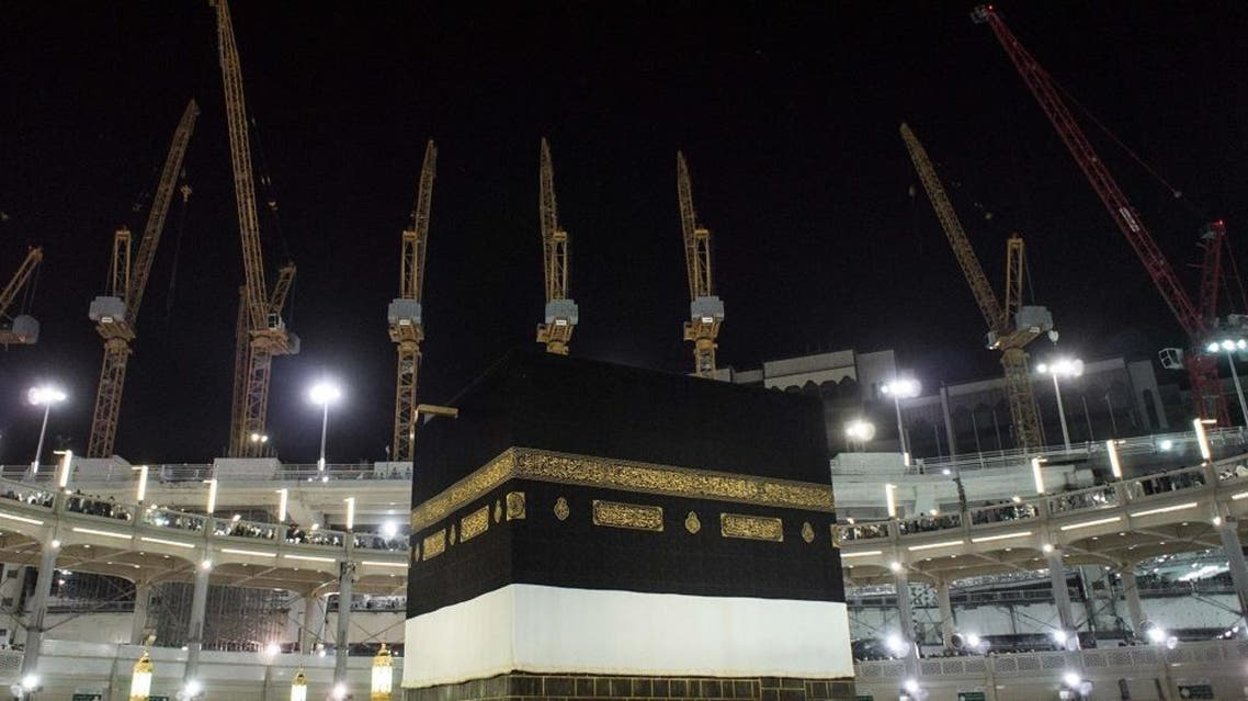 Towering construction cranes used in the ongoing expansion the Grand Mosque overlook the Kaaba, the cubic building at the mosque in the Muslim holy city of Mecca, Saudi Arabia, Sunday, Sept. 13, 2015. (AP Photo/Mosa'ab Elshamy)