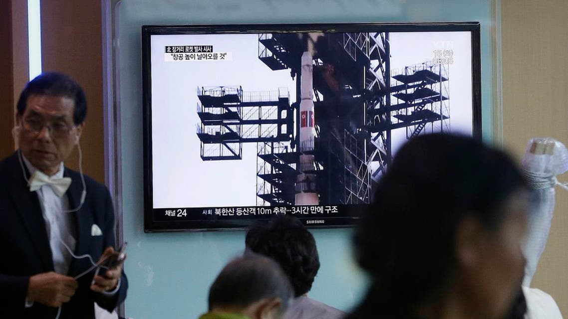 A TV screen shows a file footage of the Unha rocket in North Korea, at Seoul Railway Station in Seoul, South Korea
