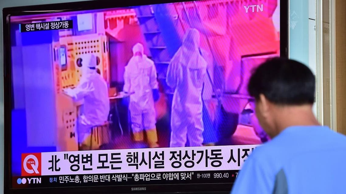 A man watches a news report at a railway station in Seoul on September 15, 2015, on the confirmation from North Korea that the nuclear reactor seen as the country's main source of weapons-grade plutonium had resumed normal operations. (AFP)