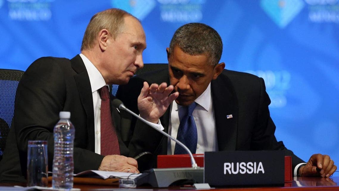 U.S. President Barack Obama, right, listens to Russia's President Vladimir Putin before the opening of the first plenary session of the G-20 Summit in Los Cabos, Mexico, Monday, June 18, 2012. (AP)