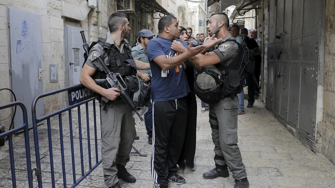Israeli border police officers detain a Palestinian protester in Jerusalem's Old City,September 14. (File photo: Reuters)