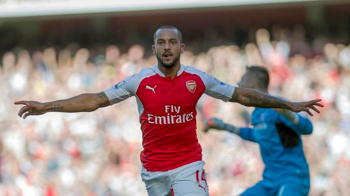 Arsenal's Theo Walcott celebrates after scoring against Stoke City, during their English Premier League soccer match between Arsenal and Stoke City, at Emirates Stadium, in London, Saturday, Sept. 12, 2015. (AP Photo/Bogdan Maran)