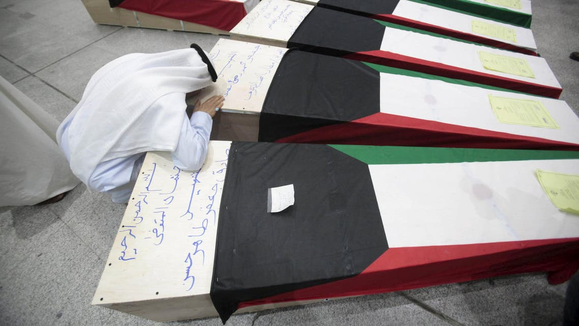 A man reacts next to coffins of victims of Friday's bombing at the Imam Sadeq mosque in Kuwait City. (File photo: Reuters)