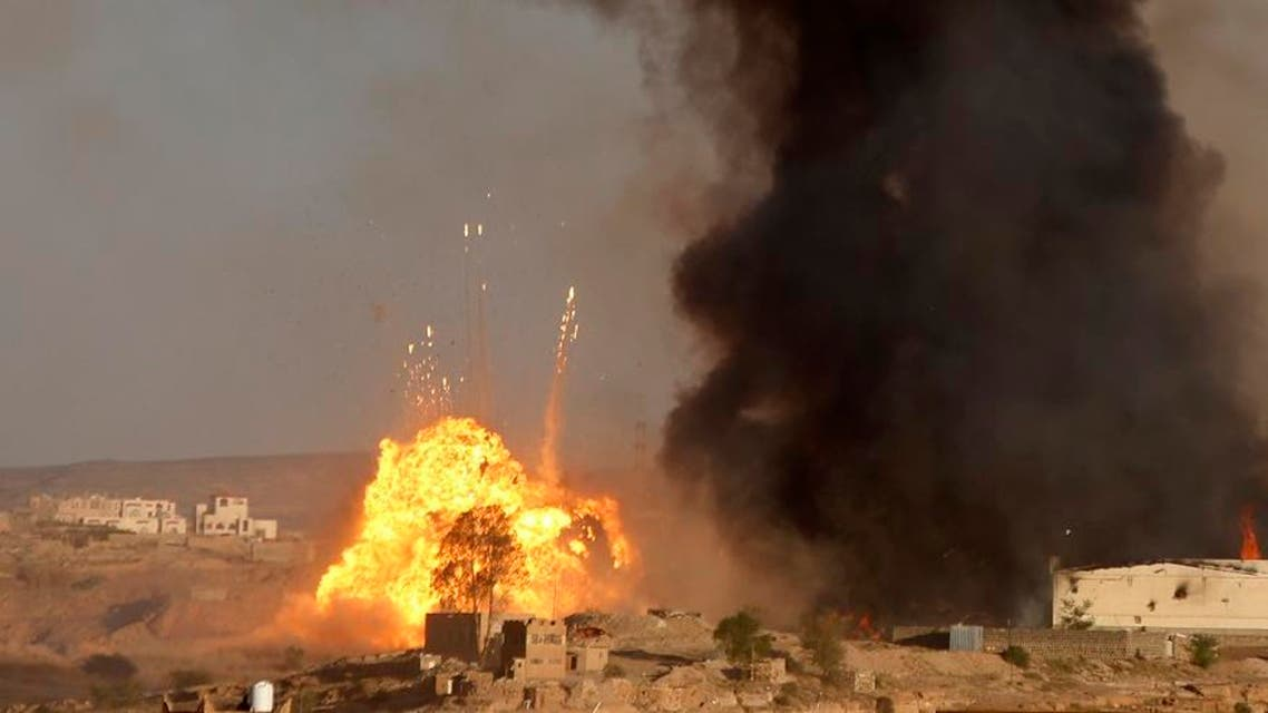 An explosion and smoke rise after an airstrike by the Saudi-led coalition at a weapons depot in Sanaa, Yemen, Friday, Sept. 11, 2015. Saudi Arabia is leading a coalition of mainly Gulf nations fighting the Houthis, who seized the capital, Sanaa, last September. (AP Photo/Hani Mohammed)