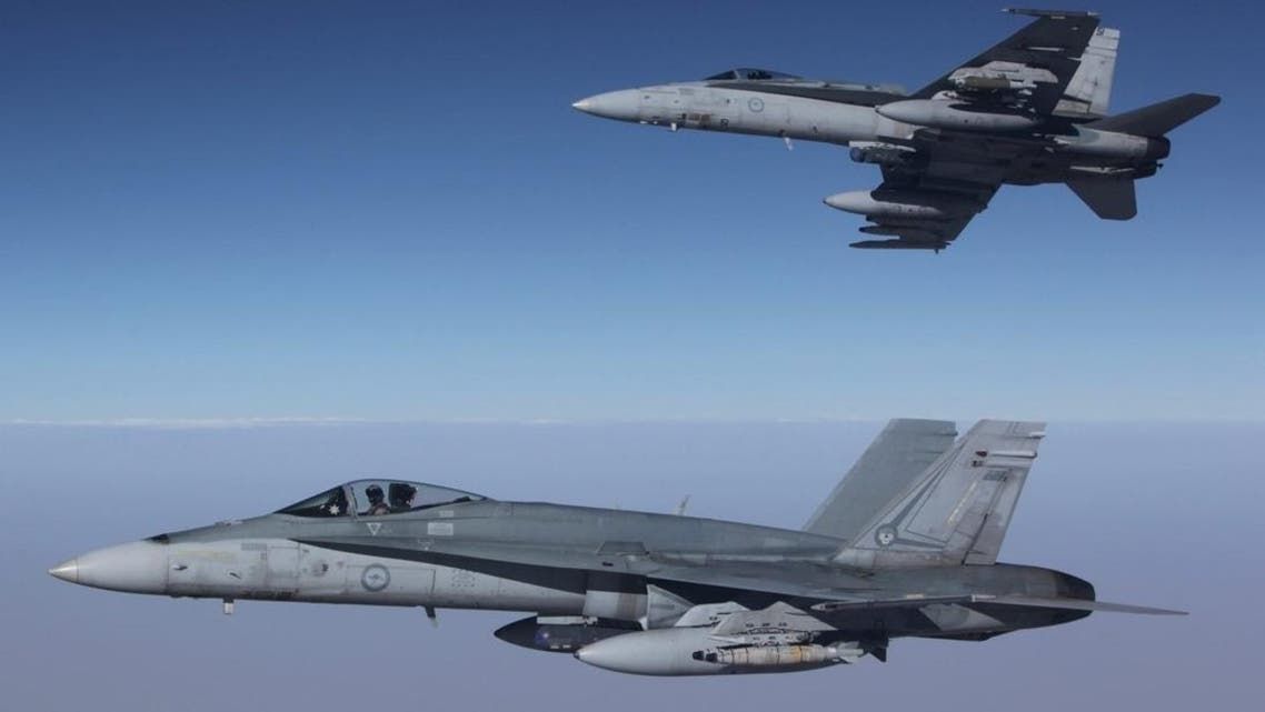 This photo taken on September 11, 2015 and released by the Royal Australian Air Force shows F/A-18A Hornets from Australia's Air Task Group flying in formation after refueling during the first mission of Operation OKRA to be flown over Syria. (AFP)