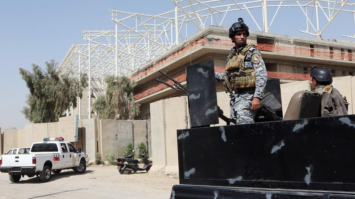 Iraqi security forces guard the entrance to a sports complex being built by a Turkish construction company, in the Shiite district of Sadr City, Baghdad, Iraq, Wednesday, Sept. 2, 2015. AP