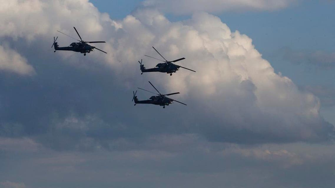 Russian MI-28 attack helicopters fly during the Army-2015 show at a shooting range in Alabino, outside of Moscow, Russia, on Tuesday, June 16. (File photo: AP)