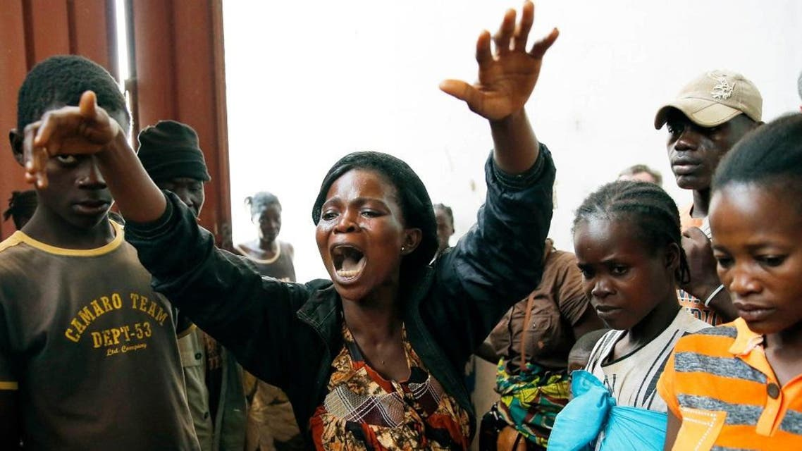 Diane Seresona is overwhelmed by grief as she sees the body of Prudence Seresona, 27, who just passed away from Malaria at the makeshift IDP camp in Bangui. (File photo: AP)