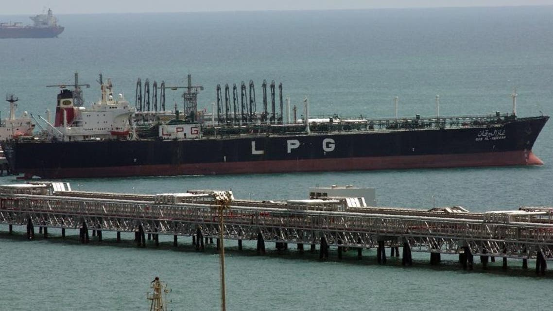 In this June 2008 file image a tanker ship from KOTC (Kuwait Oil Tankers Co) loads liquefied petroleum gas at Ahmadi pier, 40 kms south of Kuwait City . A Kuwaiti court has convicted four former officials of a state-owned oil tanker company of embezzling over US$100 million and sentenced them to up to 55 years in jail, according to a court document obtained Monday June 29, 2009. (AP File Photo/Gustavo Ferrari,File)