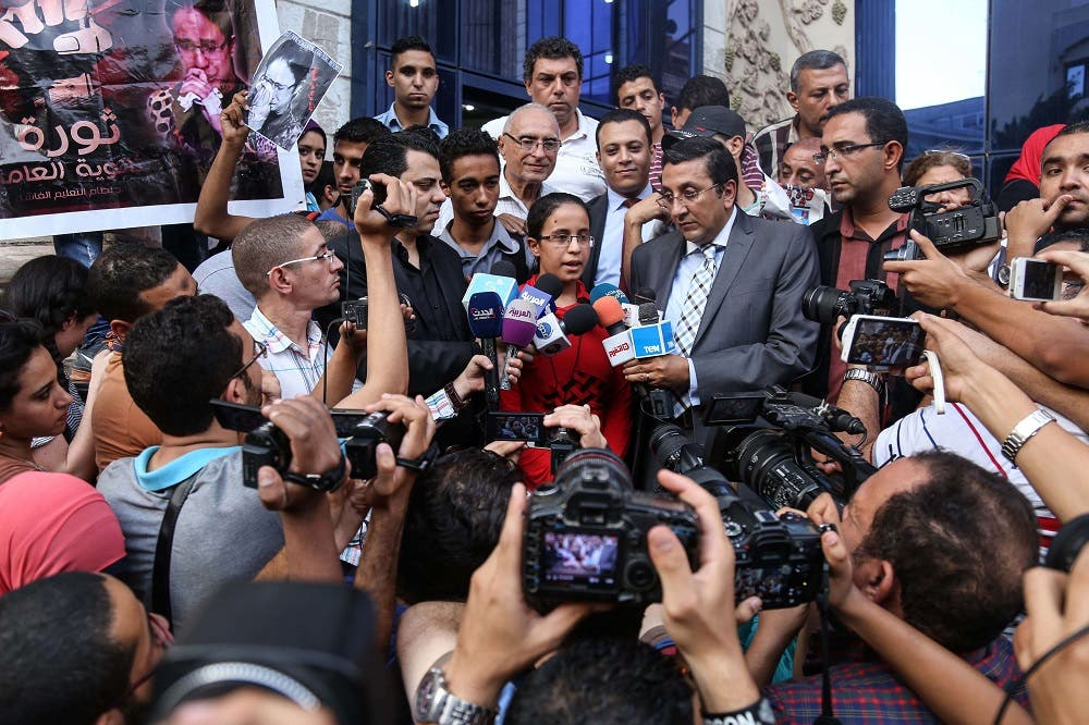 Egyptian student Mariam Malak (C), 19, talks to the press outside the syndicate of journalists in the capital Cairo on September 17, 2015.