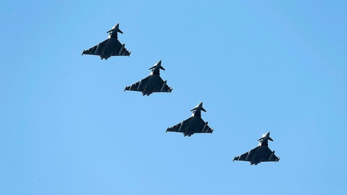 Four British Eurofighter Typhoons from the Royal Air Force arrive at Bodoe Main Air Station on the first day of the NATO Arctic Challenge Exercise, May 25. (Reuters)
