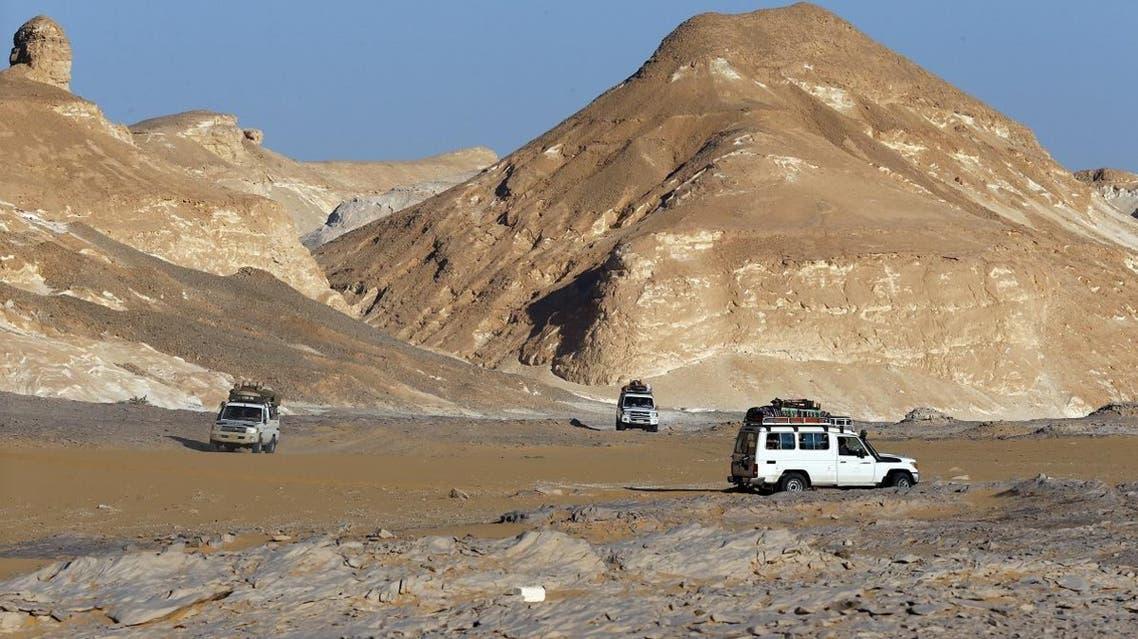 Four-wheel drive cars cross the Egyptian western desert and the Bahariya Oasis. (Reuters)