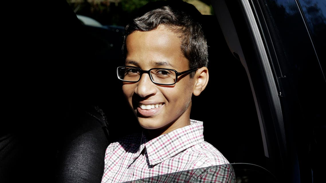 Ahmed Mohamed, 14, smiles as he sits in a vehicle before leaving his family's home in Irving, Texas, Thursday, Sept. 17, 2015.  (AP)