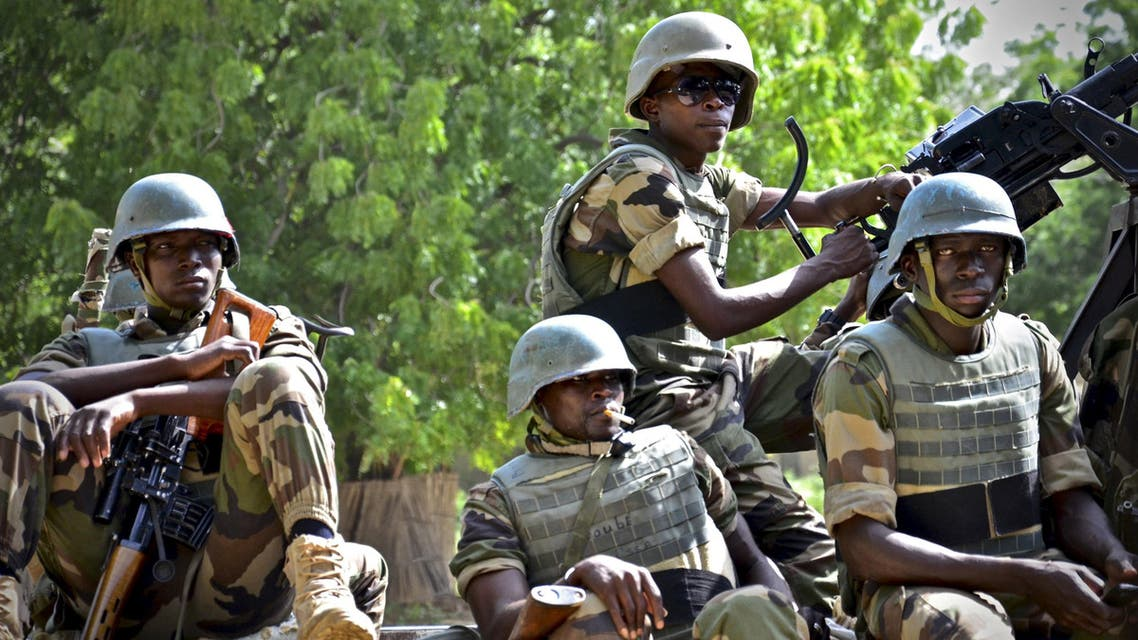 Niger soldiers provide security for an anti-Boko Haram summit in Diffa city, Niger September 3, 2015. Picture taken September 3, 2015. To match Exclusive USA-NIGER/BOKO HARAM REUTERS/Warren Strobel
