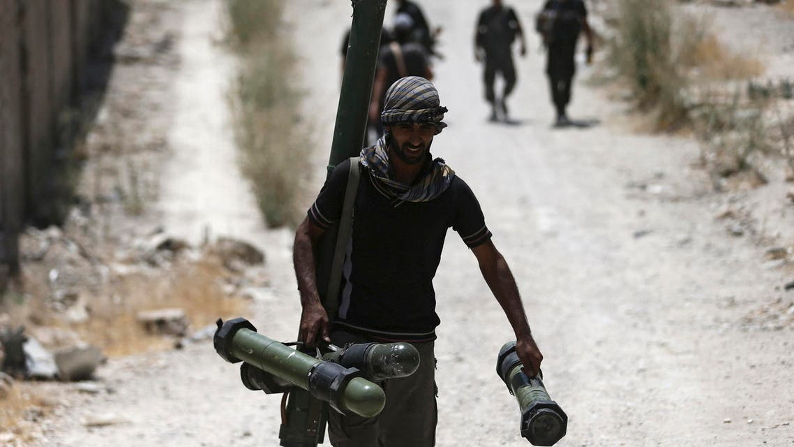 A Free Syrian Army fighter carries a weapon as he walks towards his position on the front line against Assad forces in a Damascus suburb, Syria, in this July 27, 2015 file photo. (Reuters)