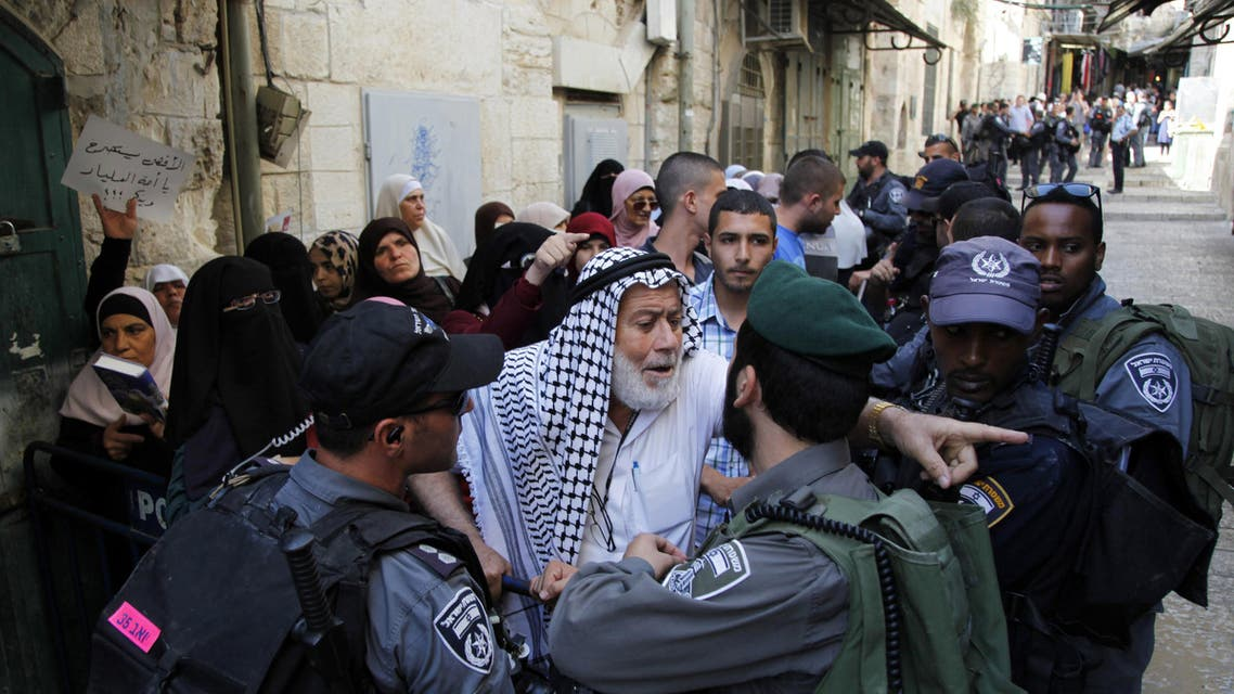A Palestinian man argues with an Israeli border police officer during a protest in Jerusalem's Old City on Thursday, Sept. 17, 2015. (AP)
