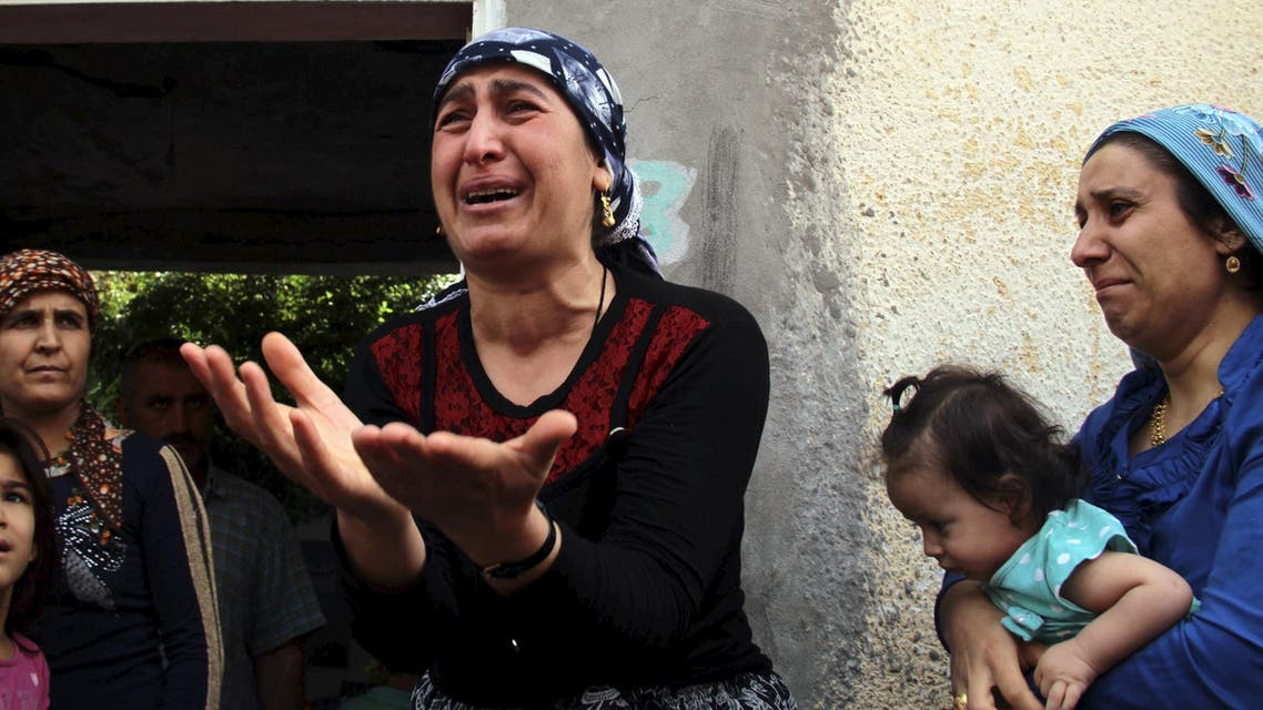 A Turkish Kurdish woman reacts as she talks to visiting journalists in the southeastern town of Cizre in Sirnak province, Turkey, September 12, 2015. (Reuters)