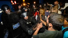Slovenia border police fire tear gas at migrants