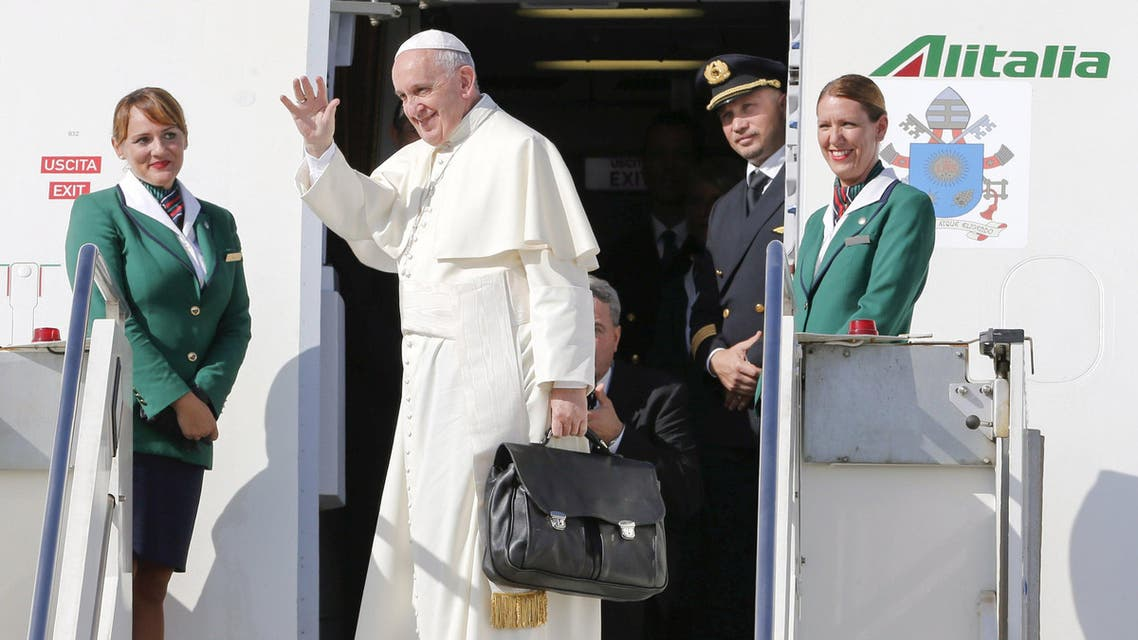 Pope Francis waves as he boards a plane at Fiumicino Airport in Rome September 19, 2015. Pope Francis begins a nine-day tour of Cuba and the United States on Saturday where he will see both the benefits and complexities of a fast-evolving detente between the old Cold War foes that he helped broker. REUTERS/Giampiero Sposito TPX IMAGES OF THE DAY