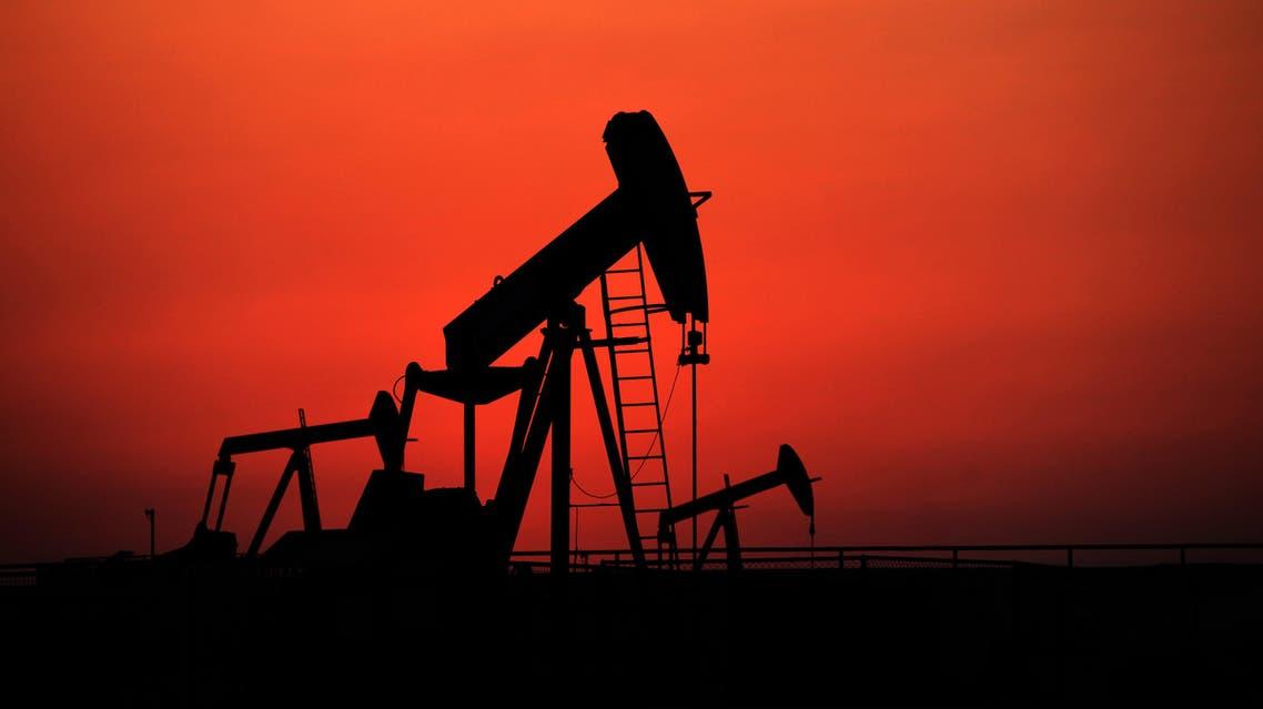 Oil pumps work at sunset on Wednesday, Sept. 11, 2013, in the desert oil fields of Sakhir, Bahrain. ap