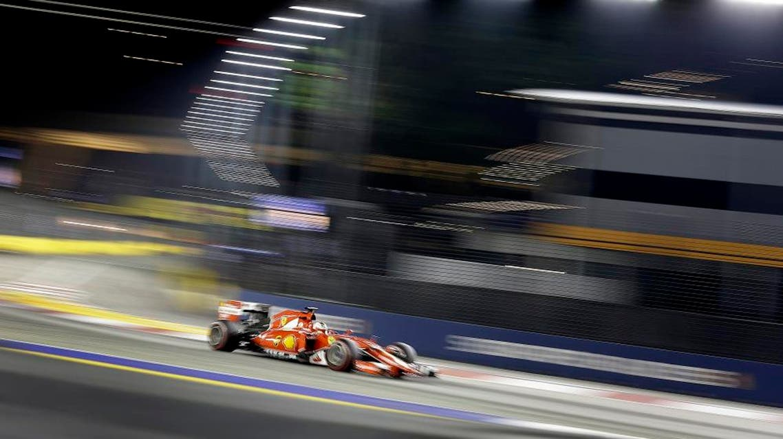 Ferrari driver Sebastian Vettel of Germany steers his car during the Singapore Formula One Grand Prix on the Marina Bay City Circuit in Singapore, Sunday, Sept. 20, 2015. (AP Photo/Wong Maye-E)