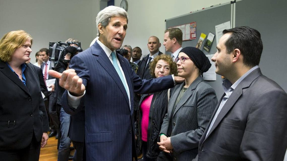 U.S. Secretary of State John Kerry (C) meets with refugees fleeing Syria at Villa Borsig in Berlin, Germany, September 20, 2015. (Reuters)