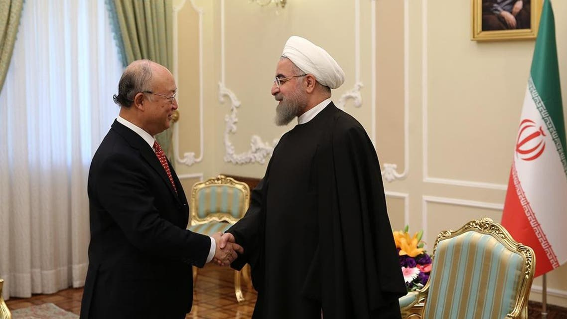 A handout picture released the official website of the Iranian President Hassan Rouhani shows him (R) meeting with UN atomic agency chief Yukiya Amano as a December deadline looms for the completion of a long-running investigation into the country's past nuclear activities on September 20, 2015 in the capital Tehran. AFP