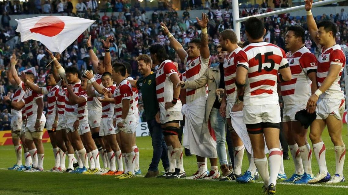 Japan teammates celebrates with the crowd after defeating South Africa 32-34 in the Rugby World Cup Pool B match at the Brighton Community Stadium, Brighton, England Saturday, Sept. 19, 2015. (AP Photo/Tim Ireland)