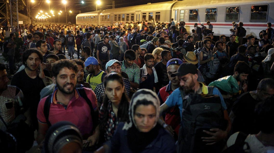 Migrants leave after failing to board a train at the train station in Tovarnik, Croatia September 19, 2015.