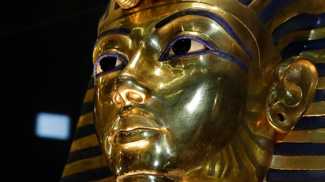 The gold mask of King Tutankhamun is seen in its glass case during a press tour, in the Egyptian Museum near Tahrir Square, Cairo, Egypt, Saturday, Jan. 24, 2015. AP