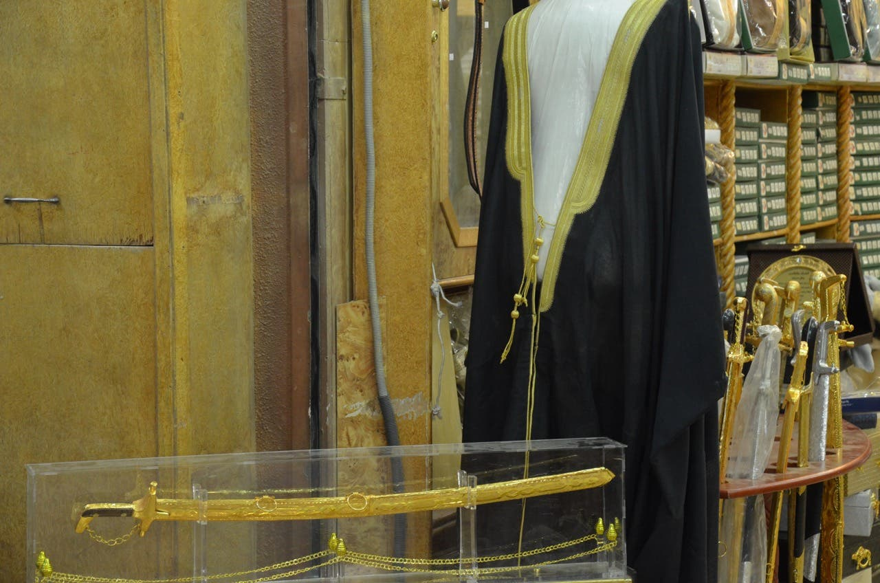 A bisht (cloak) and saif (ceremonial sword). (Photo: Miles Lawrence)