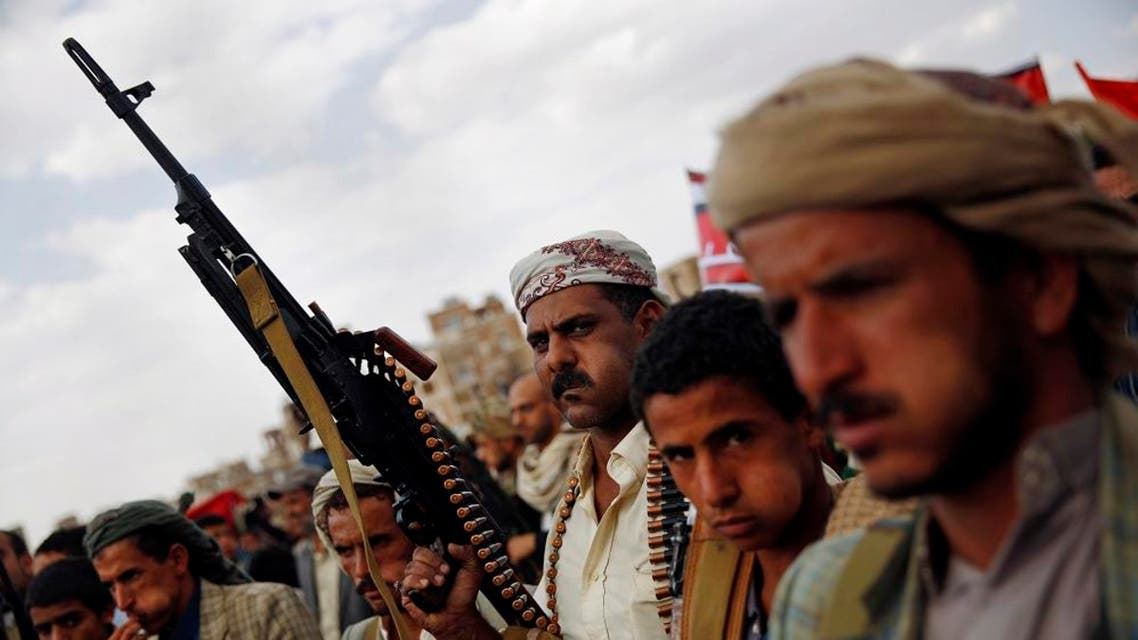A Shiite Houthi rebel holds his weapon as he attends a rally to protest Saudi-led airstrikes, in Sanaa, Yemen, Monday, Aug. 24, 2015. AP