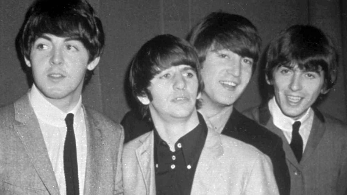 The Beatles are shown on an album cover in 1965. Clockwise, from top left, are: Paul McCartney, Ringo Starr, John Lennon, and George Harrison. (AP